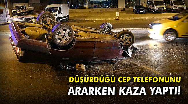 Düşürdüğü cep telefonunu ararken kaza yaptı!