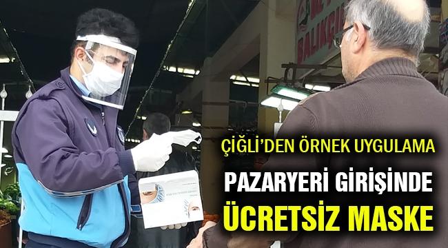 Çiğli'de örnek uygulama: Pazaryeri girişinde vatandaşa ücretsiz maske