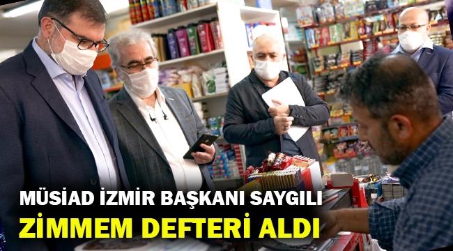 MÜSİAD İzmir Şube Başkanı Bilal Saygılı 'zimem defteri' satın aldı