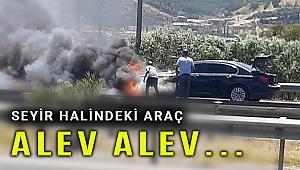 İzmir'de hareket halindeki otomobil yandı sürücü zor kurtuldu