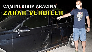 Belediye Başkanı ve koruması trafikte tartıştığı kişinin aracına zarar verdiler