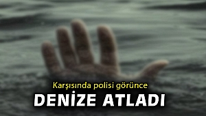 İzmir'de hakkında yakalama kararı bulunan kişi, polis kontrolünde denize atladı