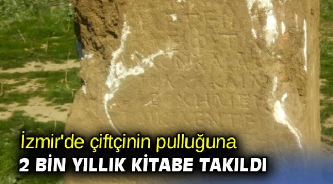 İzmir'de çiftçinin pulluğuna 2 bin yıllık kitabe takıldı
