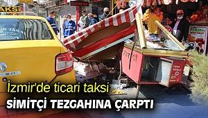 İzmir'de ticari taksi simitçi tezgahına çarptı