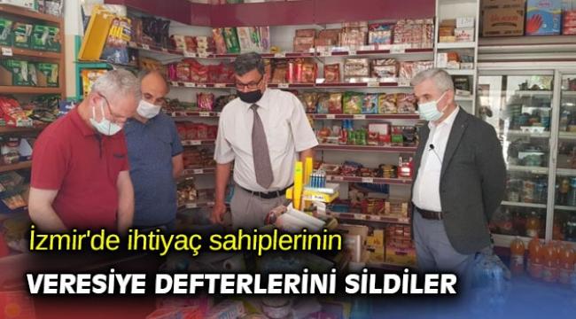 İzmir'de ihtiyaç sahiplerinin veresiye defterlerini sildiler