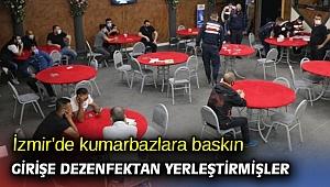 İzmir'de kumarbazlara baskın: Girişe dezenfektan yerleştirmişler
