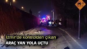 İzmir'de kontrolden çıkan araç yan yola uçtu